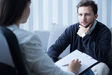 Counselling session for a man in need of therapy.