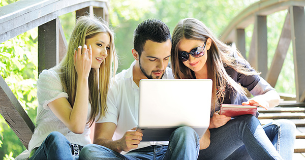 Technology on campus: students using a laptop.